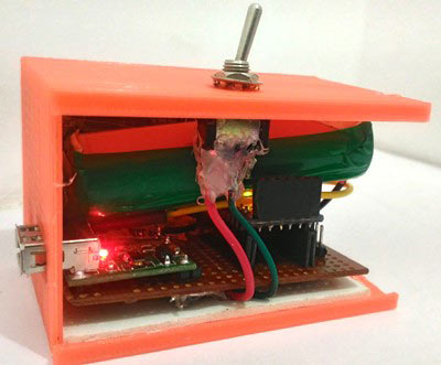 Perf-board-inside-3D-printed-speedometer-box-with-battery-2