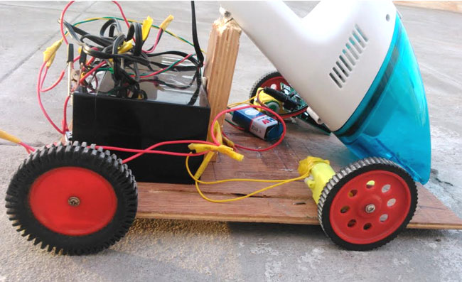 Arduino Based Obstacle Avoiding Vacuum Cleaner Robot