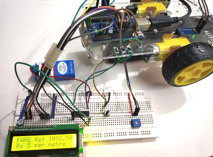 Digital Taxi Fare Meter Project using Arduino and LM-393 Speed Sensor